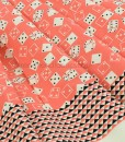 Roll the Dice Peach Dressmaking Fabric