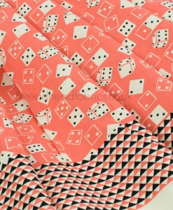 Roll the Dice Peach Dressmaking Fabric