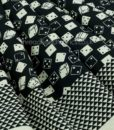 Folded Black Roll the Dice Fabric