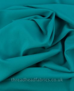 teal bi-stretch suiting fabric swirled